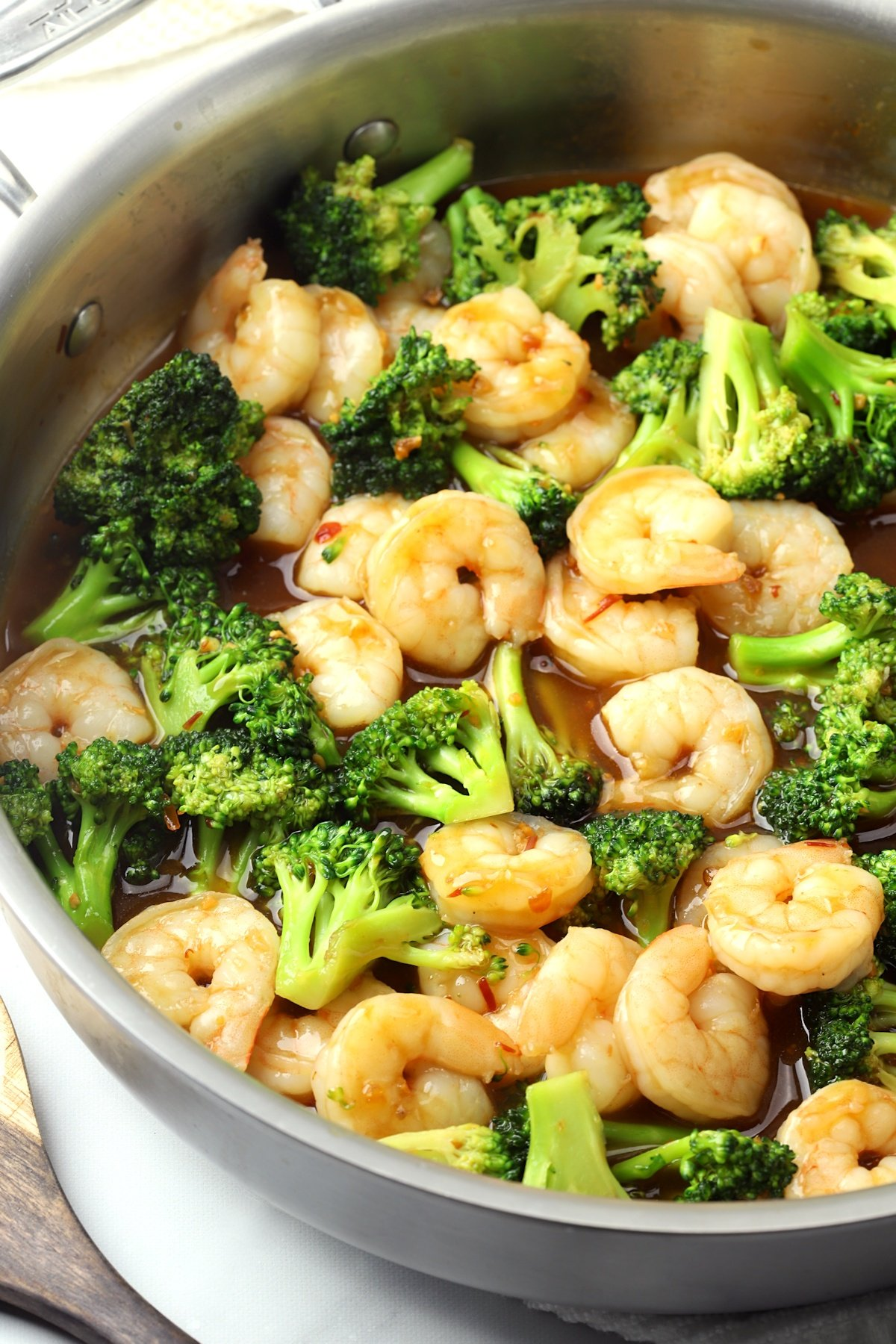 Saute pan filled with shrimp and broccoli.