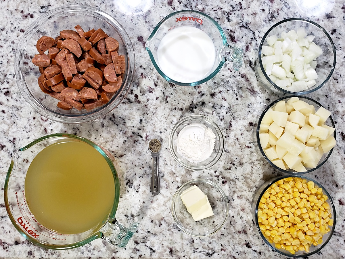 Ingredients to make corn chowder on a counter top.