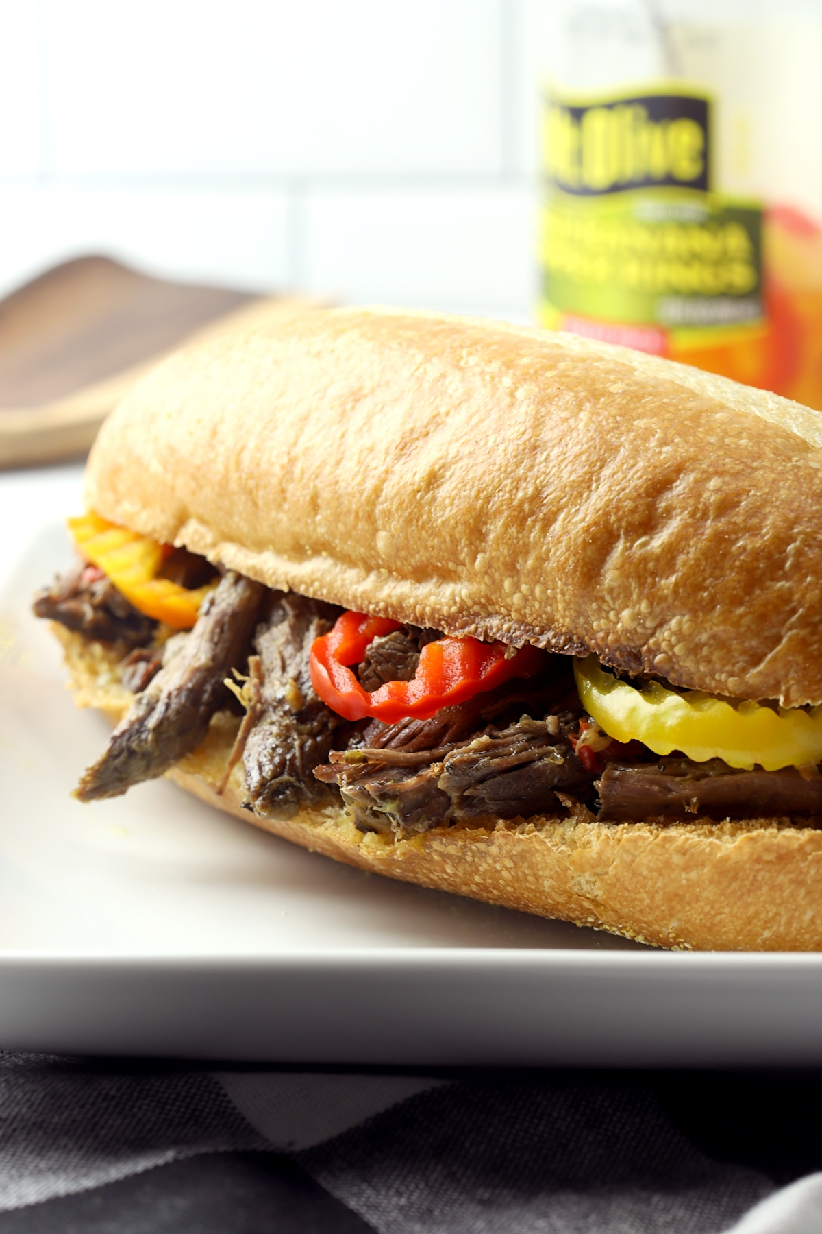 Italian beef sandwich on a white plate.