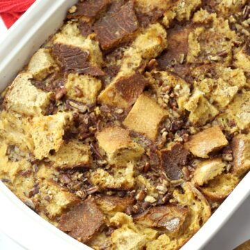 A 9x13 pan filled with bread cubes and pecans.