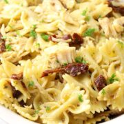 Bow tie pasta coated in a basil pesto sauce.