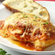 Chicken topped with pizza sauce and melted mozzarella cheese.