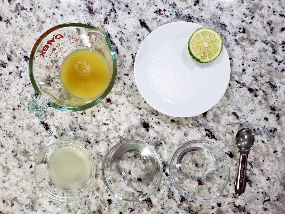 Ingredients for a pineapple margarita in bowls.