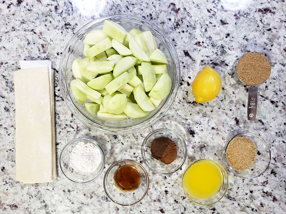 Ingredients to make apple pandowdy on a counter top.