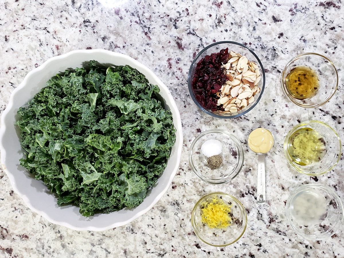 Ingredients for a kale salad on a counter top.
