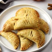 A white plate filled with pumpkin pasties.