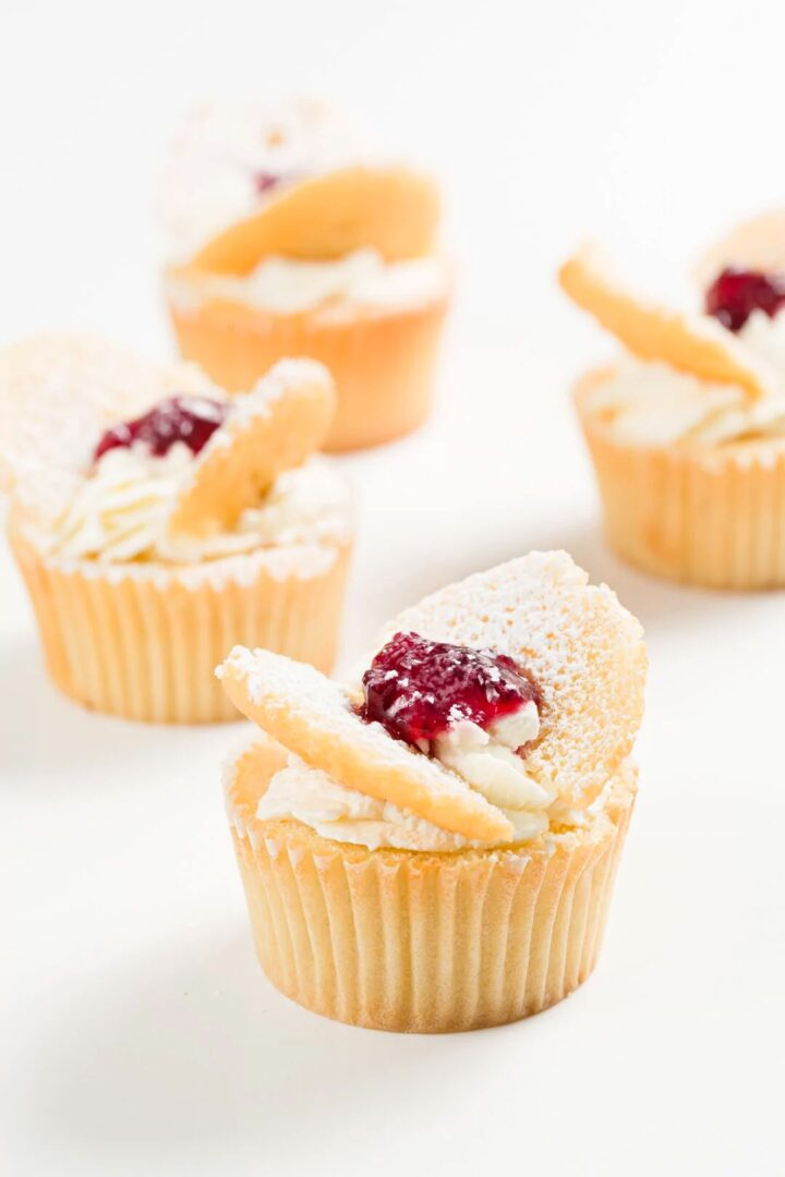 Cupcakes topped with strawberry jam.