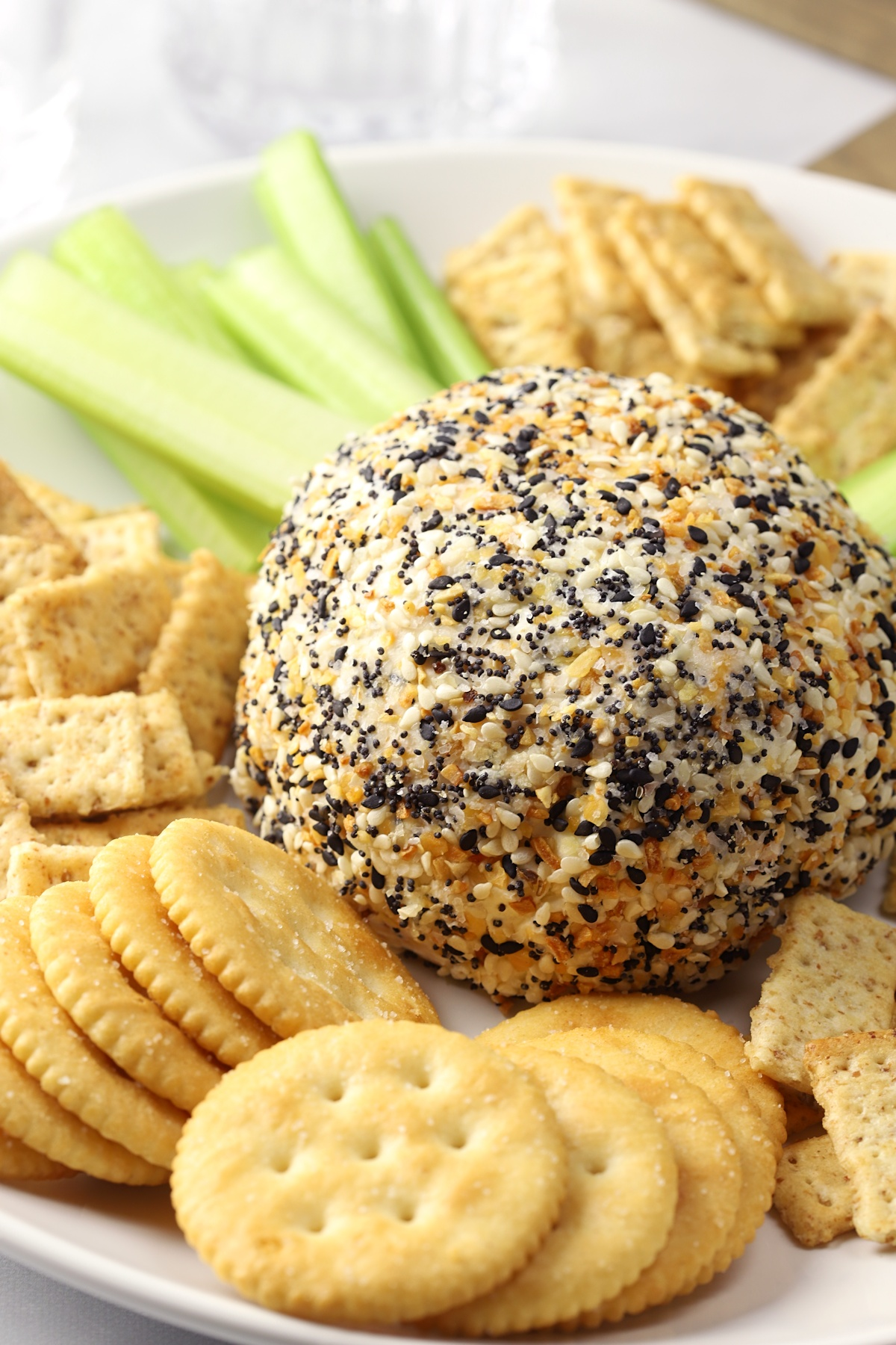 A round ball of cheese covered in everything bagel seasoning.