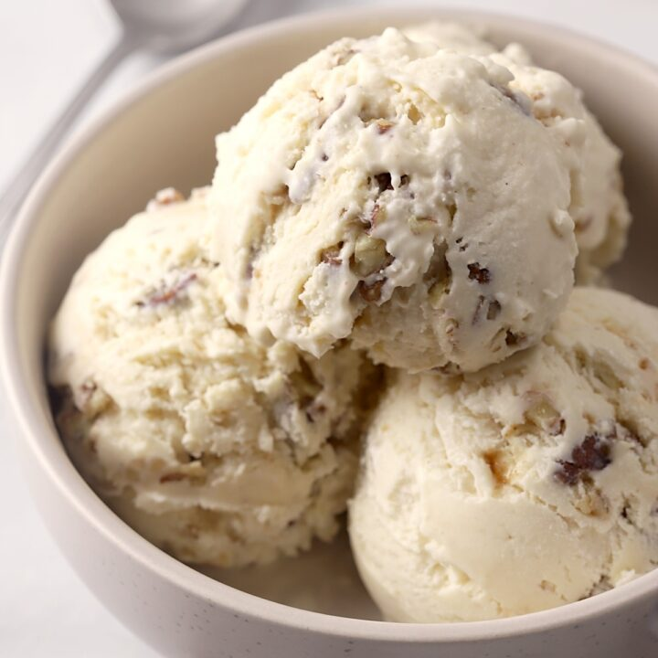 Bowl filled with scoops of ice cream.