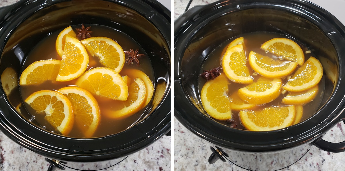 Slow cooker filled with apple cider and orange slices.