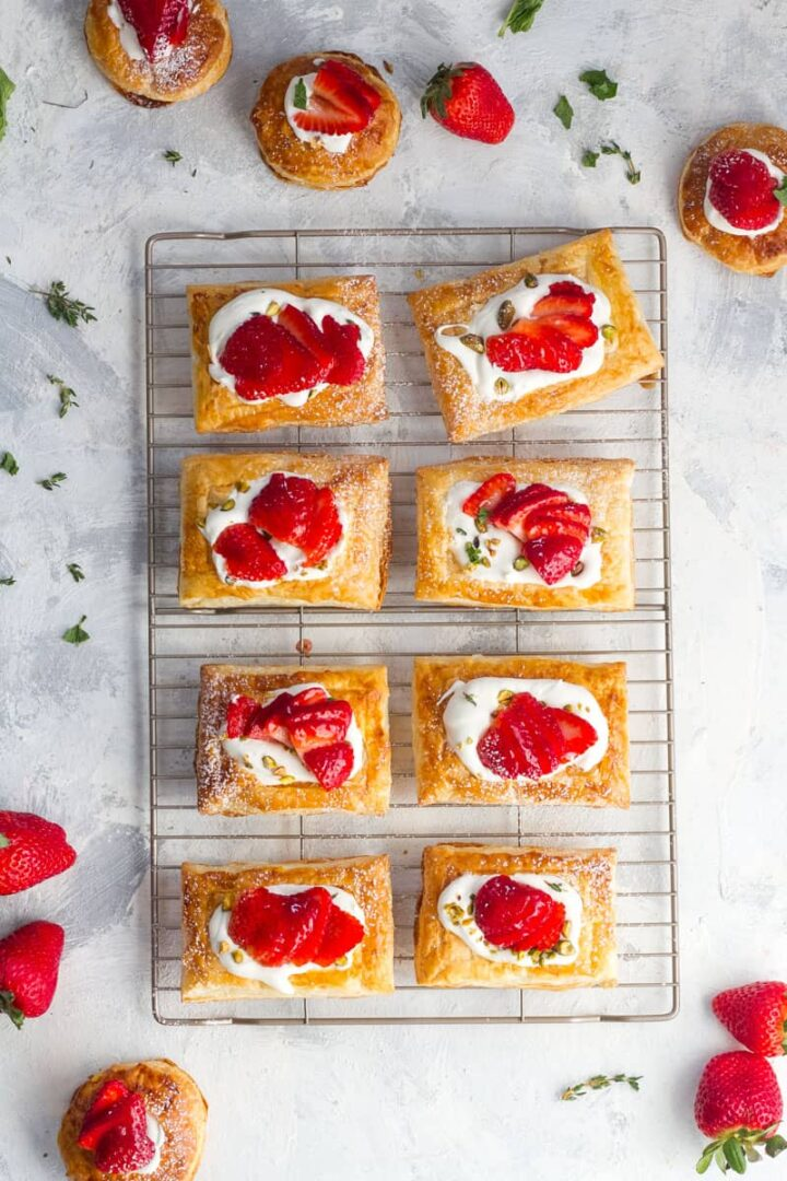 Strawberry tarts on a cooling rack.