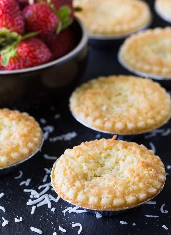 Single serve tarts on a dark counter top.