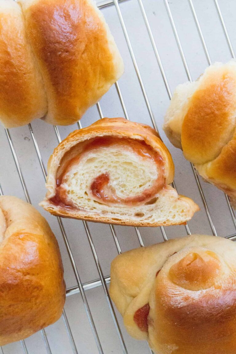 A slice of japanese milk bread on a cooling rack.