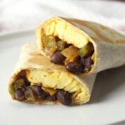 Black bean breakfast burrito cut in half.