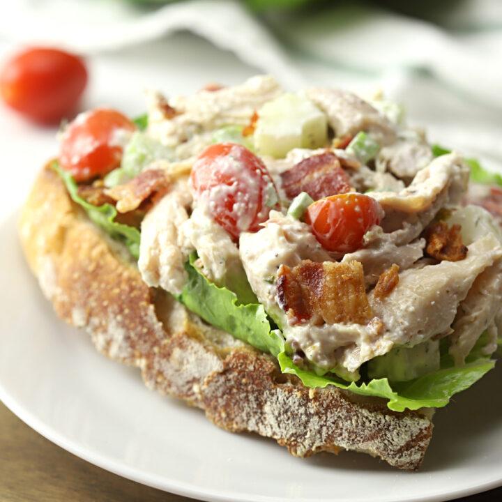 BLT chicken salad on a slice of crusty bread.