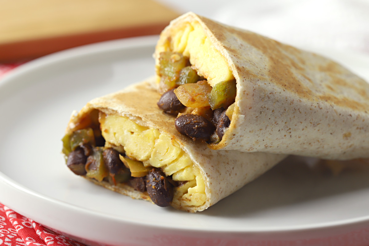 Black bean burrito on a white plate.