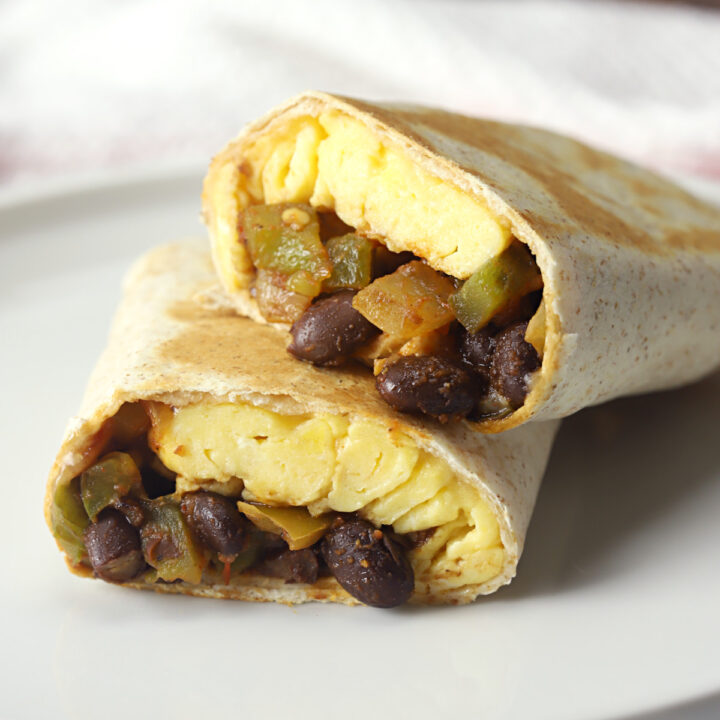 Black bean breakfast burrito cut in half.