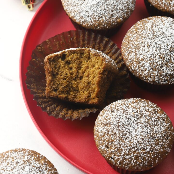 Gingerbread muffins on a red plate.