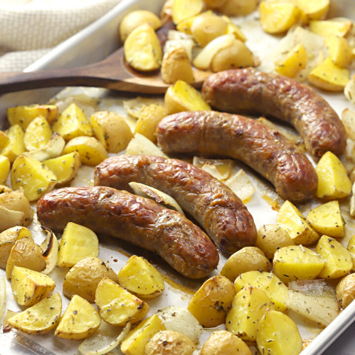 Sheet pan filled with sausage and potatoes.