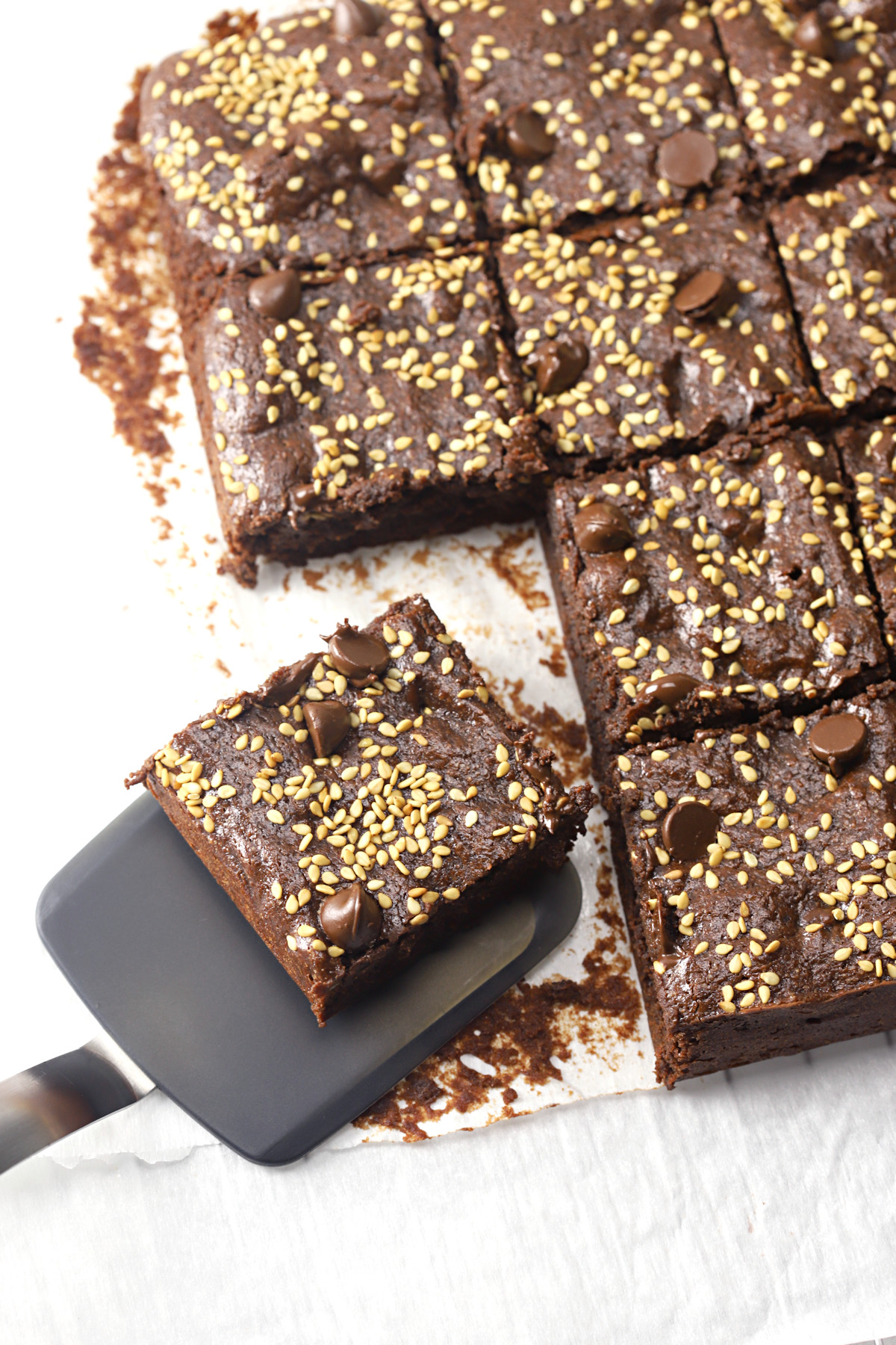 Slicing and serving tahini brownies.
