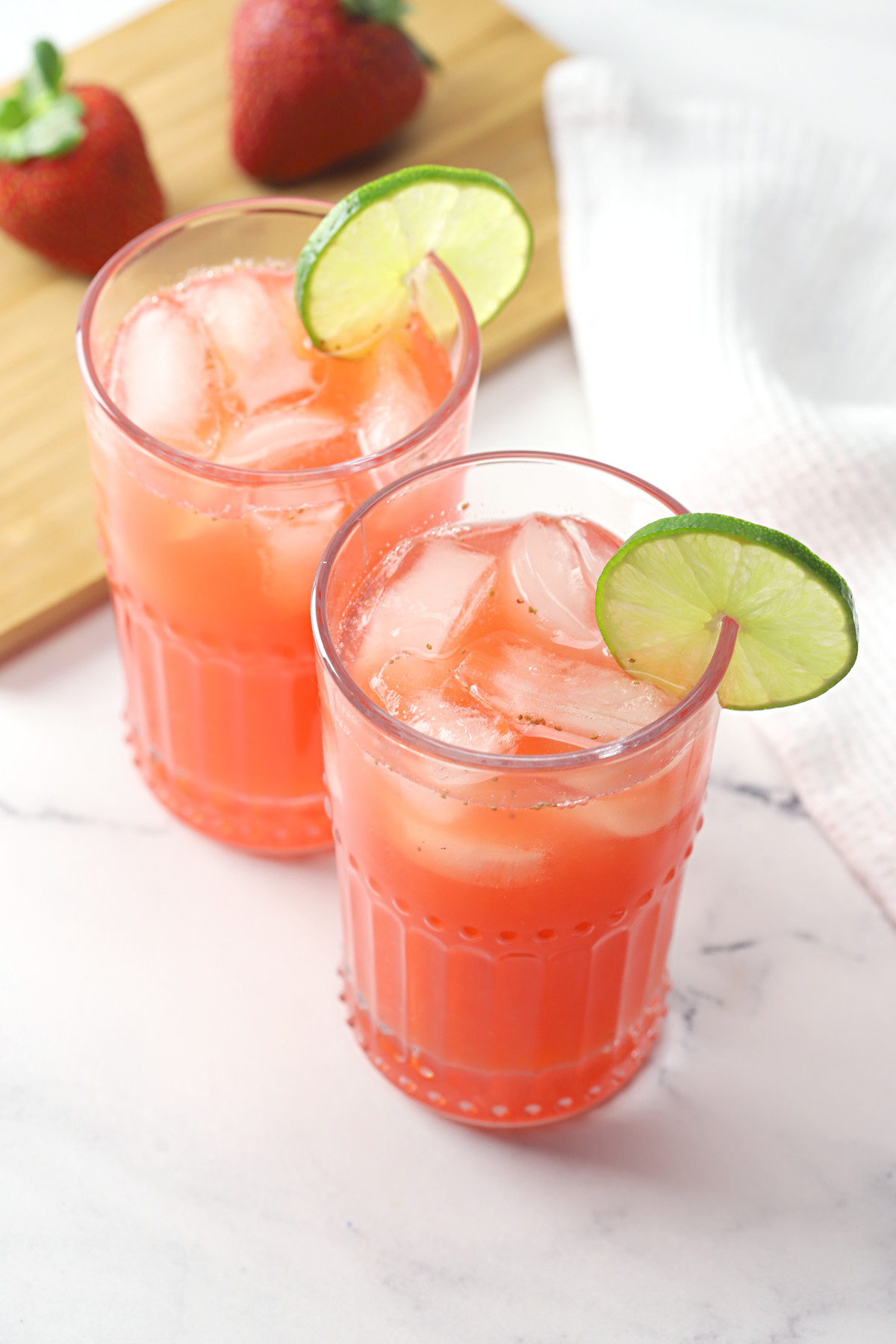 Two glasses of strawberry limeade.