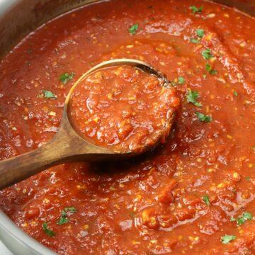 Saute pan filled with marinara sauce.