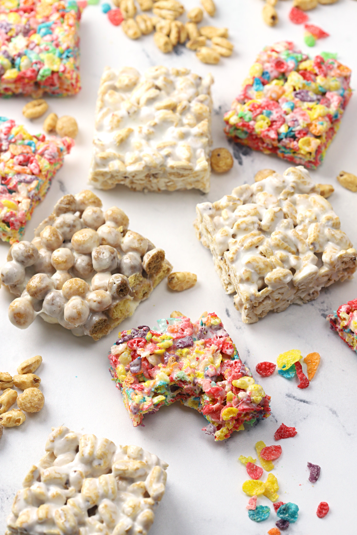 Cereal marshmallow treats on a marble counter top.