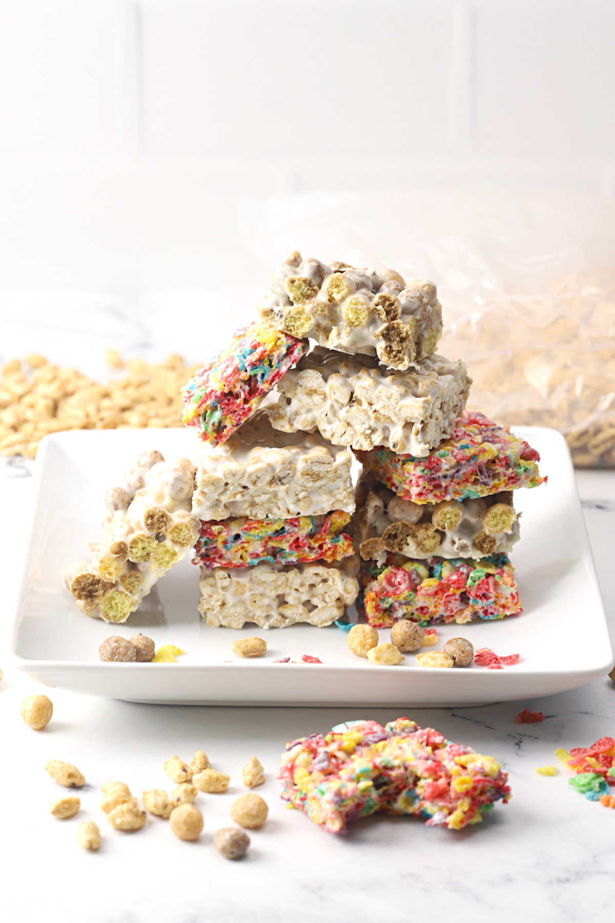 A white plate stacked with cereal marshmallow treats.