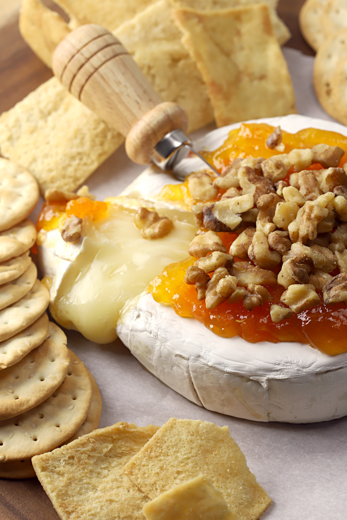 Baked brie sliced open to reveal melty center.