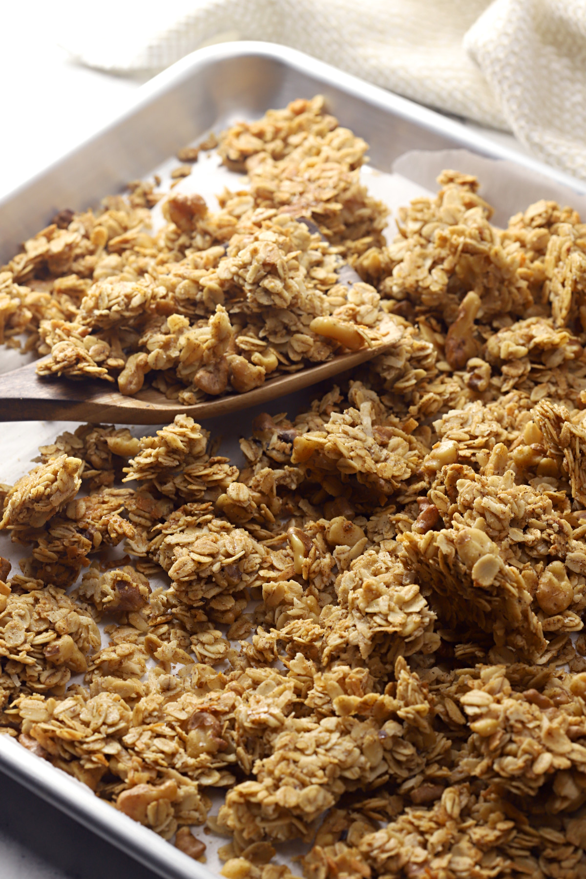 Baked granola on a sheet pan.