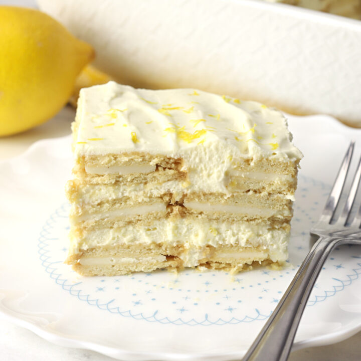 A slice of lemon icebox cake on a white plate.