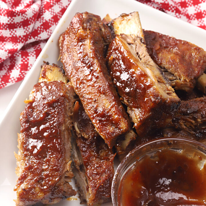 Ribs with a bowl of barbecue sauce.