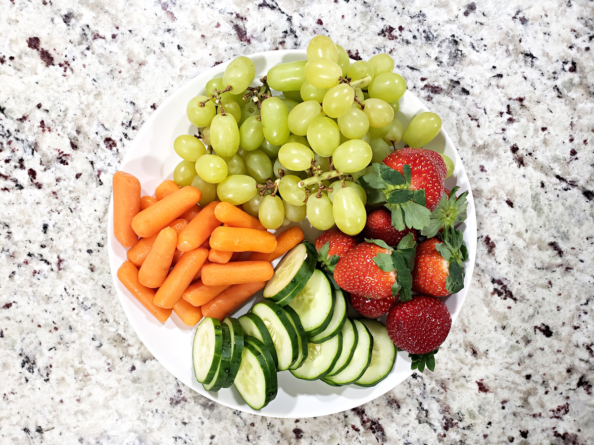 Fruit and vegetables prepared for charcuterie board.