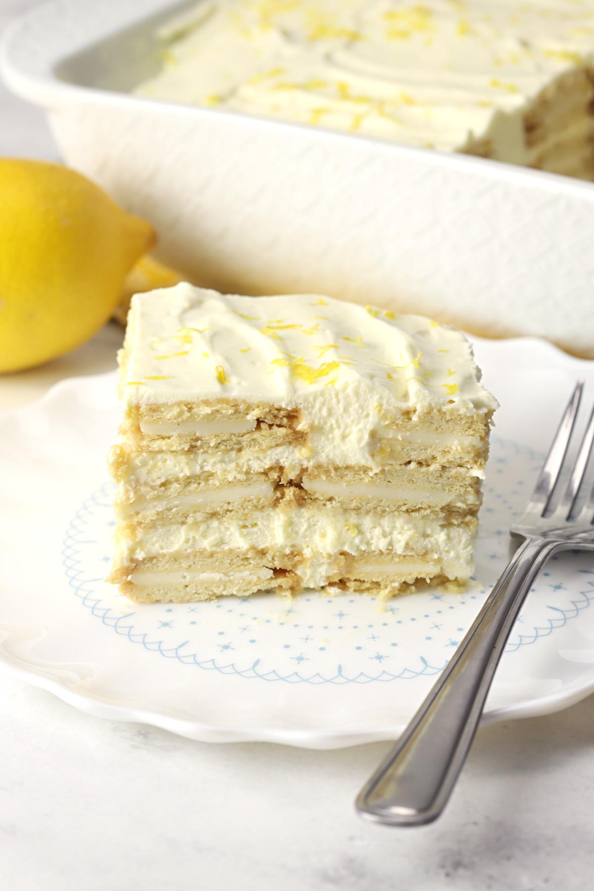 A slice of lemon icebox cake on a white dish.