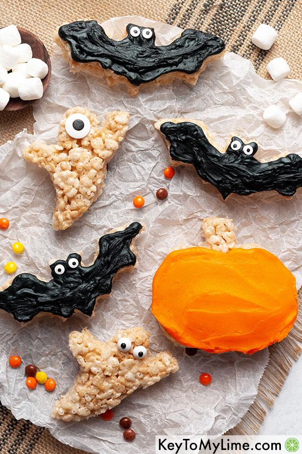 Rice krispies treats shaped like ghosts, bats, and pumpkins.