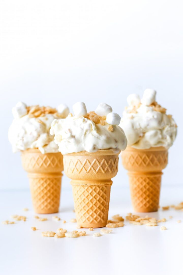Ice cream cones filled with ice cream and rice krispies bits.