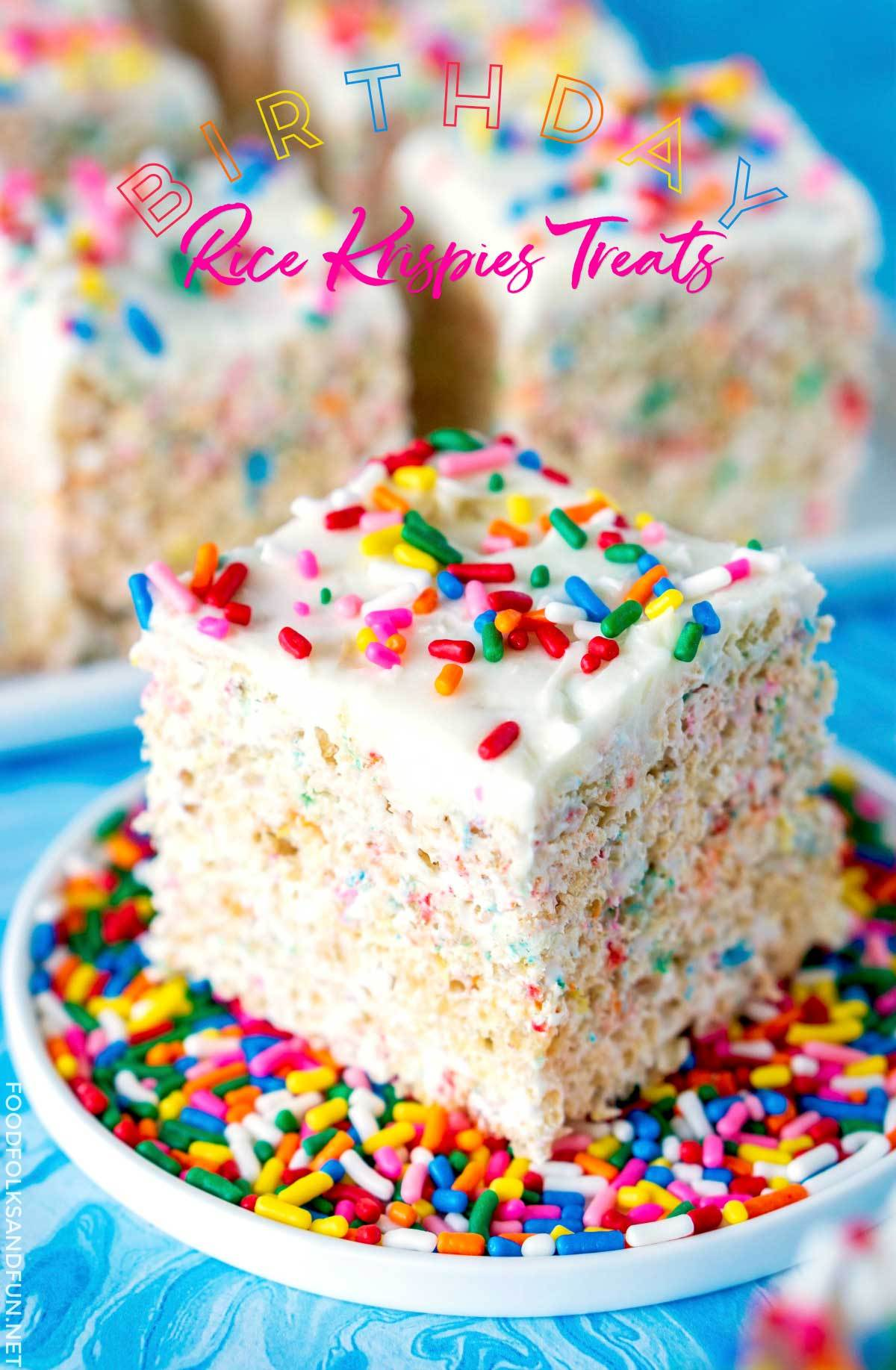 Rice krispies treat filled with rainbow sprinkles and topped with frosting.