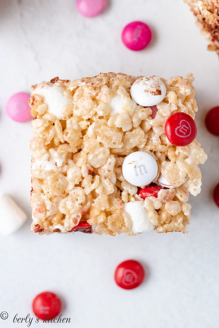 Rice krispies treat filled with valentine's day m&m's candies.