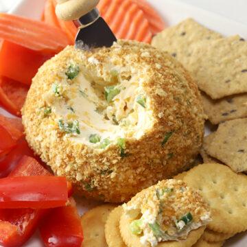 Jalapeño cheese ball spread onto a cracker.