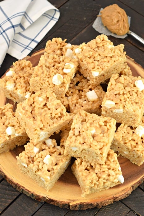 Peanut butter rice krispies treats stacked on a plate.