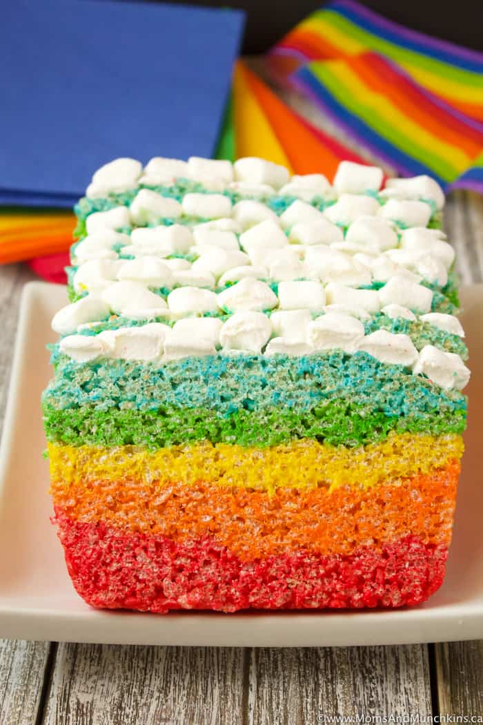 A rainbow rice krispies cake topped with marshmallows.