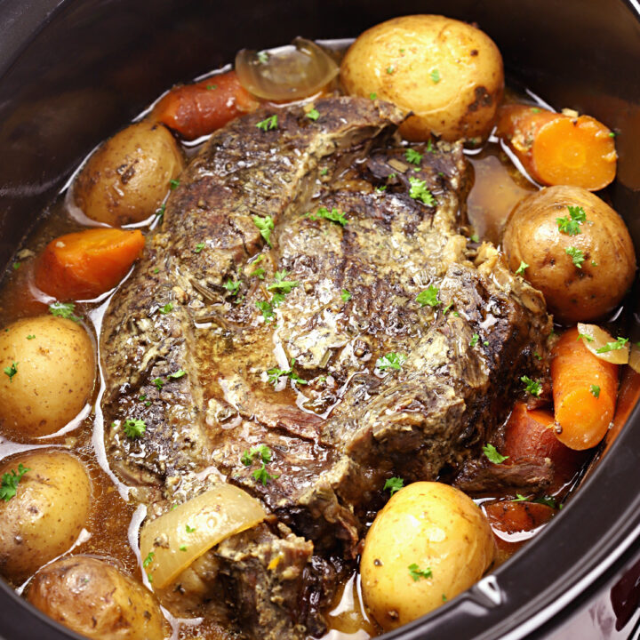 Beef roast in a large slow cooker.