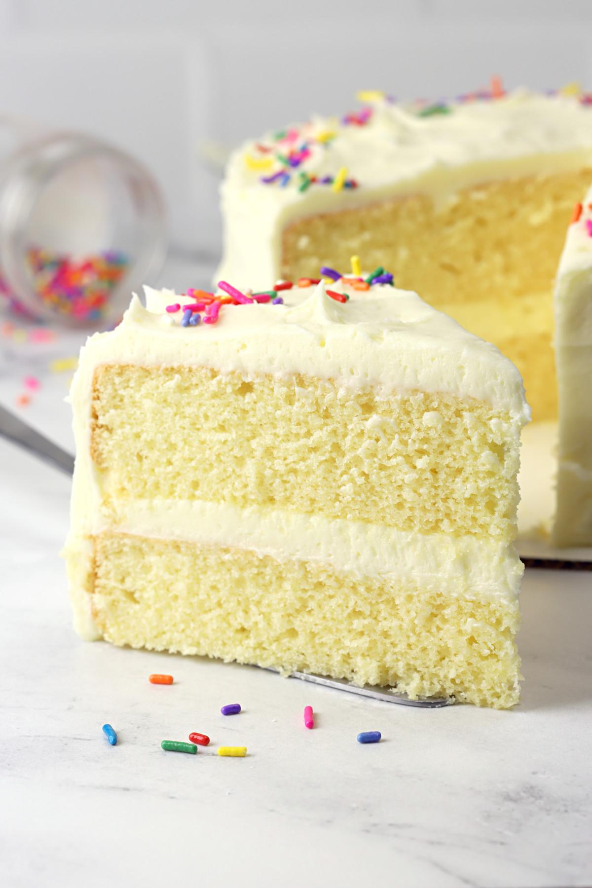 Slice of vanilla layer cake.
