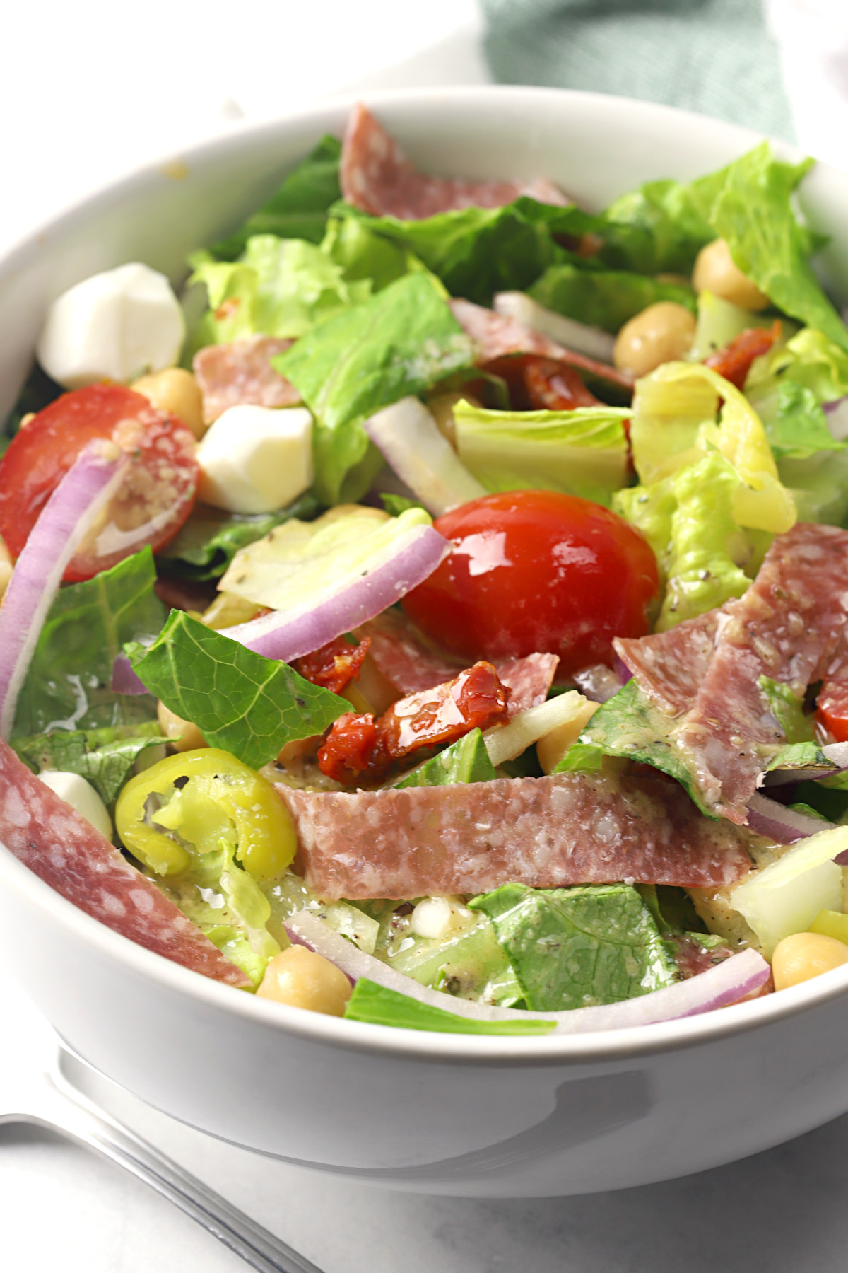 Single serving of chopped salad in a white bowl.
