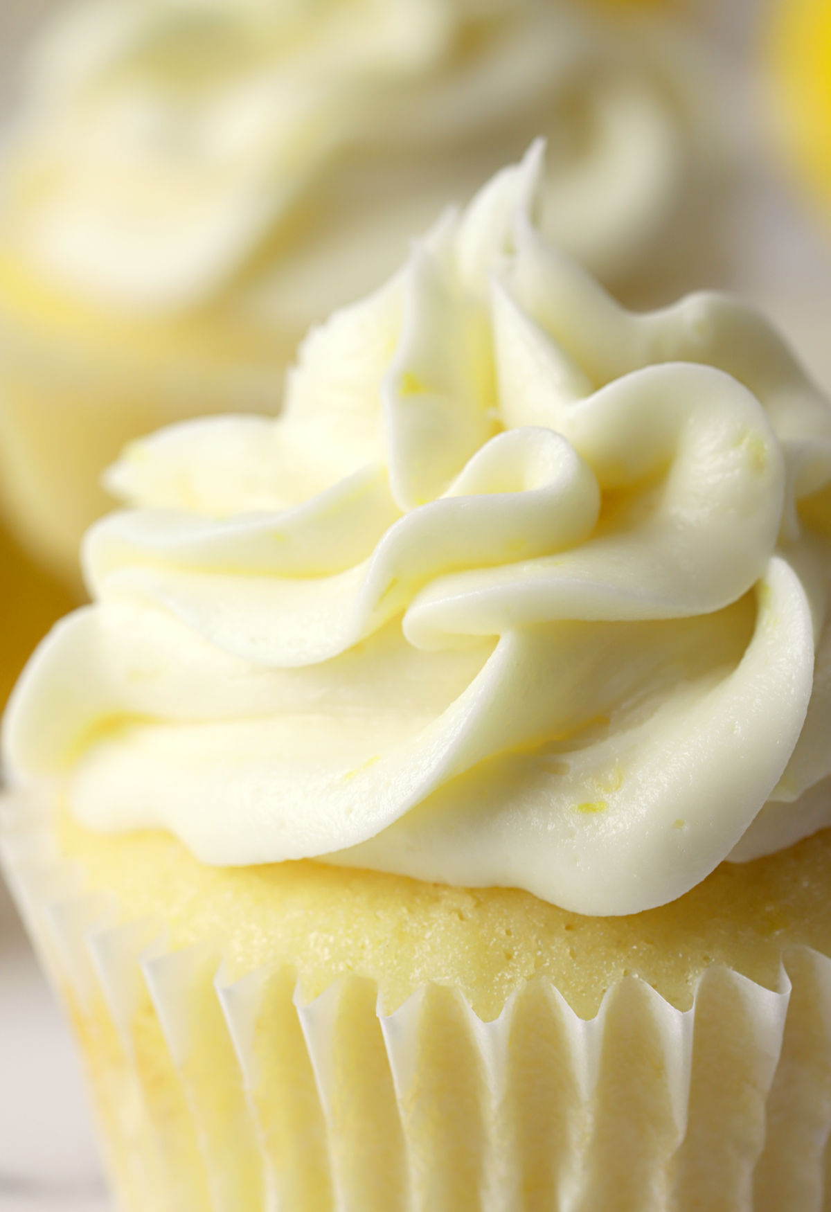 Lemon frosting piped onto a cupcake.