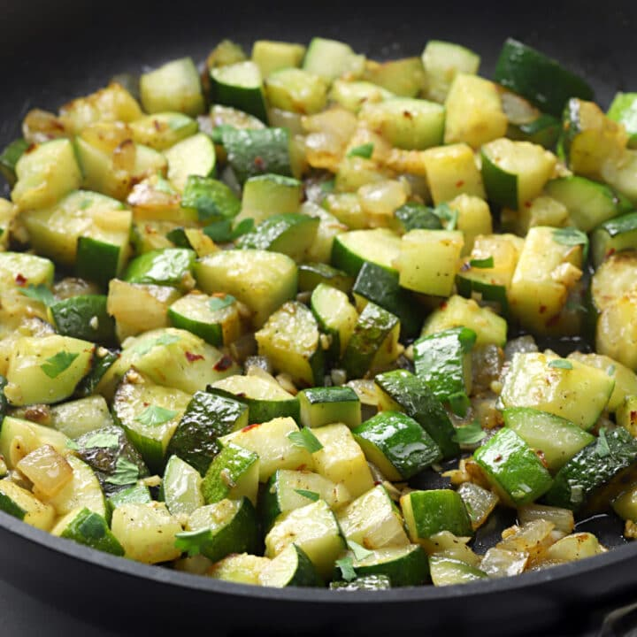 Sautéed zucchini in a skillet.